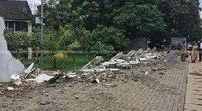 Rainstorm Destroys Rawlings' Wall