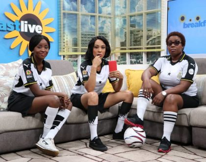 Hosts Of TV Africa's Breakfast Show Look Serious In Black Stars' Jersey