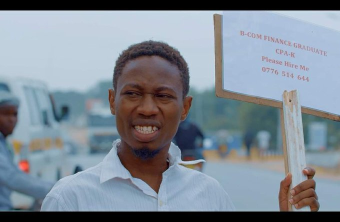 KENYAN ARTISTE KASH BIRO TAKES TO THE STREET WITH A PLACARD IN A JOB HUNTING MISSION.