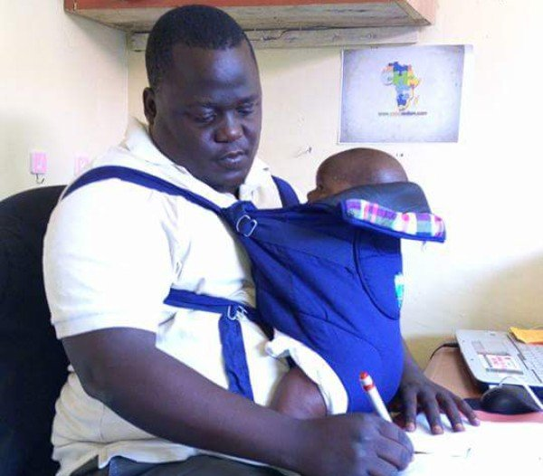 Kisumu dad Silas Odhiambo takes his baby with him to work