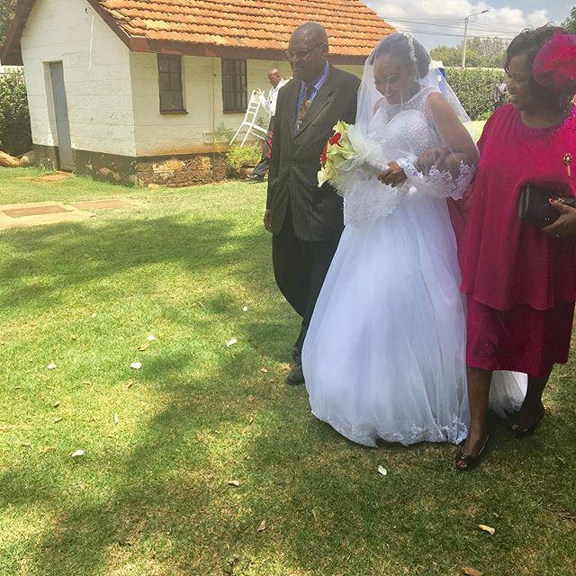 Liz Ntonjira's parents walking down the aisle