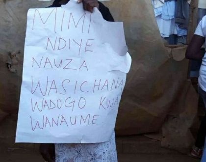 Woman frog-matched across the streets of Thika carrying a placard after she was busted hooking up young girls with old HIV+ man (Photos)