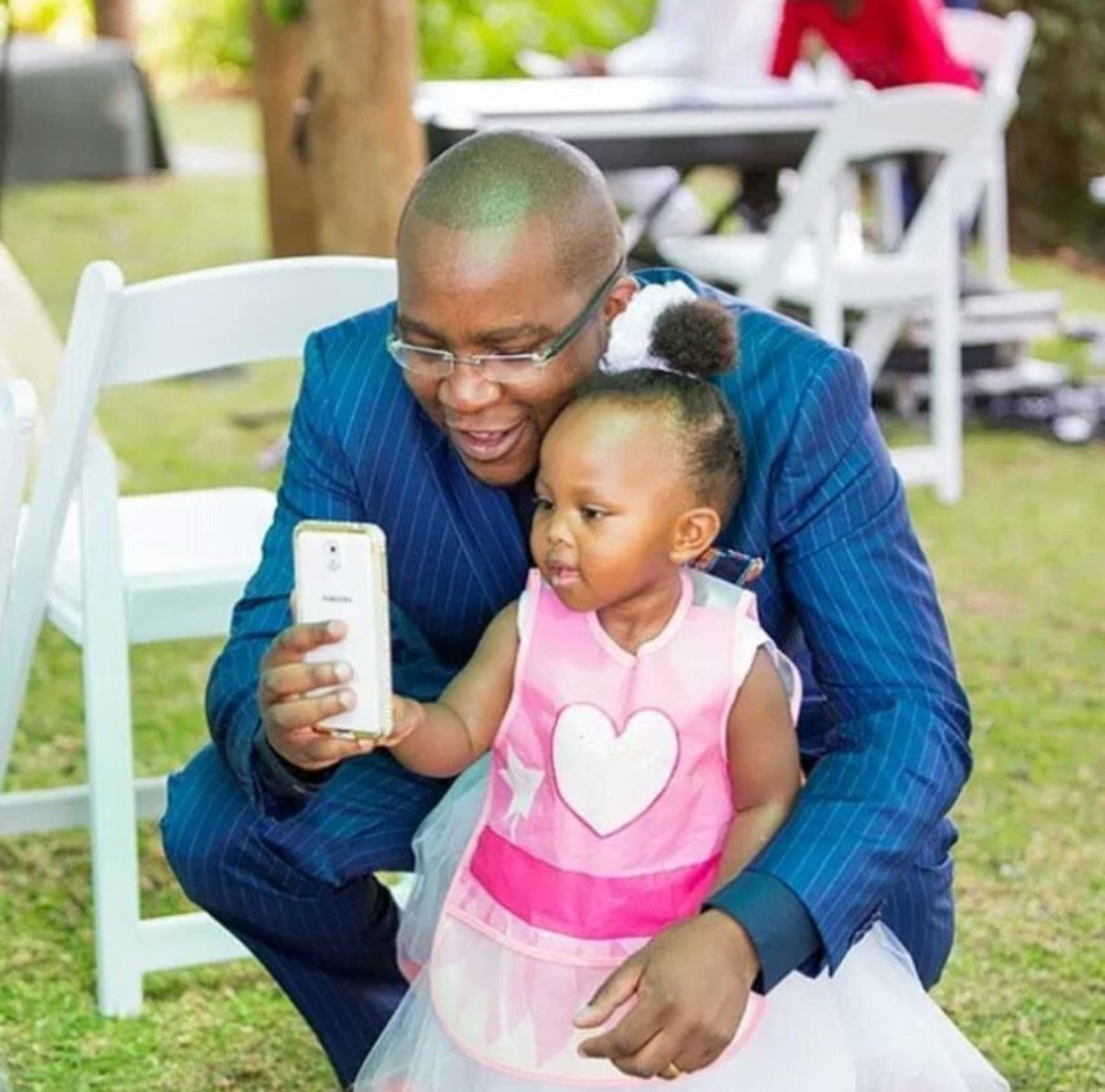Jimmy Gathu with his grand-daughter