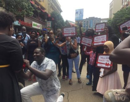 Little known comedian raises the bar for single men as he blocks traffic on Kimathi Street just to propose to his sweetheart (Photos)