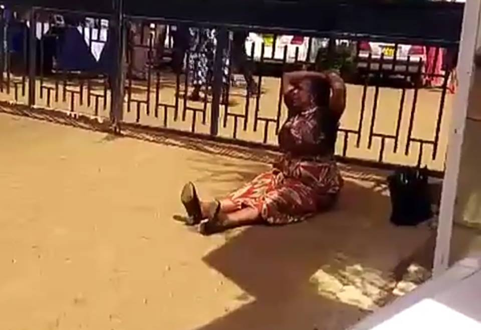 Woman cries and throws herself to the ground after she was kicked out by governor for taking pictures with President Uhuru (Video)