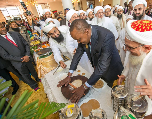 President Uhuru making chapati