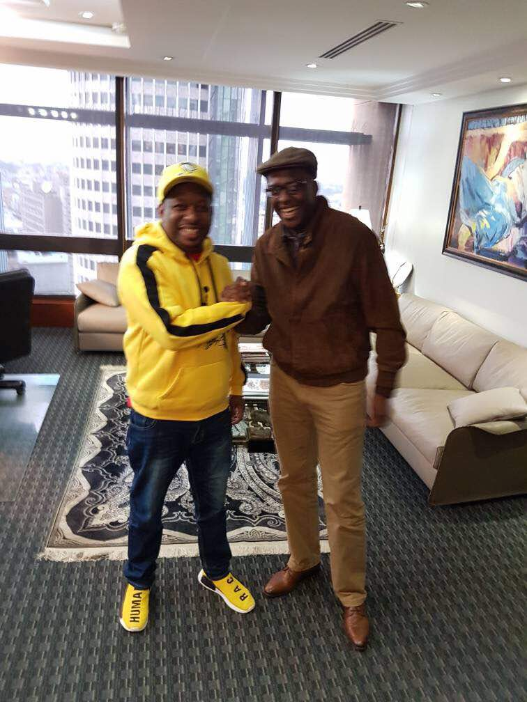 Mike Sonko rocking his expensive shoes and a matching hoodie