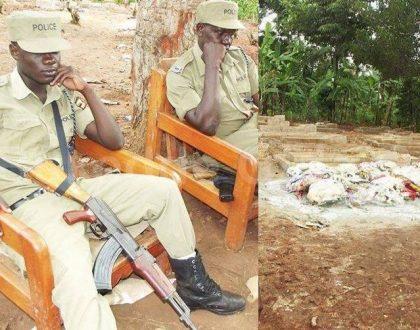 Heavily armed Ugandan police remain vigil at Ivan Ssemwanga's grave to guard against tomb raiders (Photos)