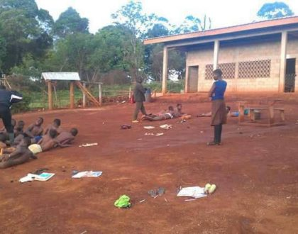 Shock as teachers strip male and female students to underwear before caning them in the open (Photos)