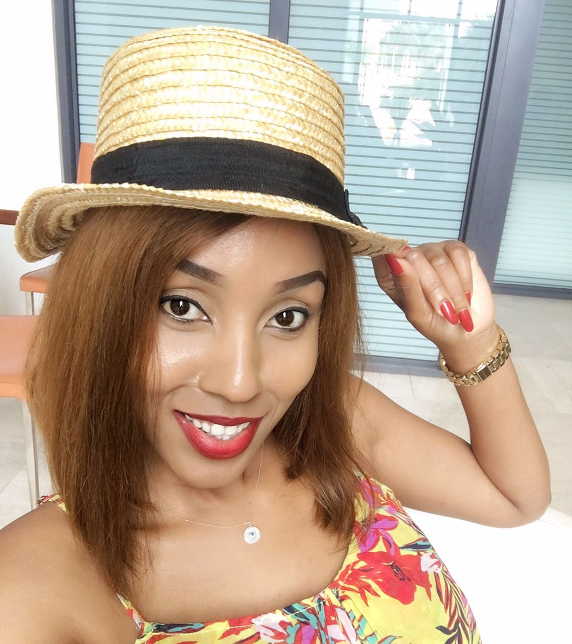 Photos of Ebru Tv 's sensation Doreen Gatwiri showing a baby bump on her vacation in Cape Town