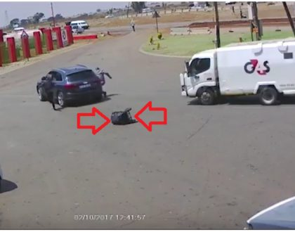 Gun drama as G4S officers risk their lives to recover bag filled with cash that had been stolen by armed robbers (Video)