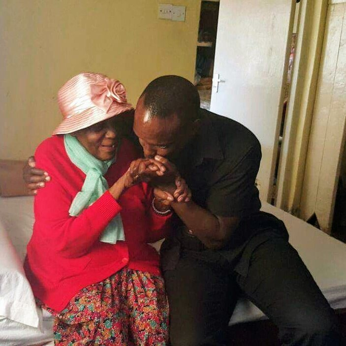 Anthony Gichuru with his great Grandmother