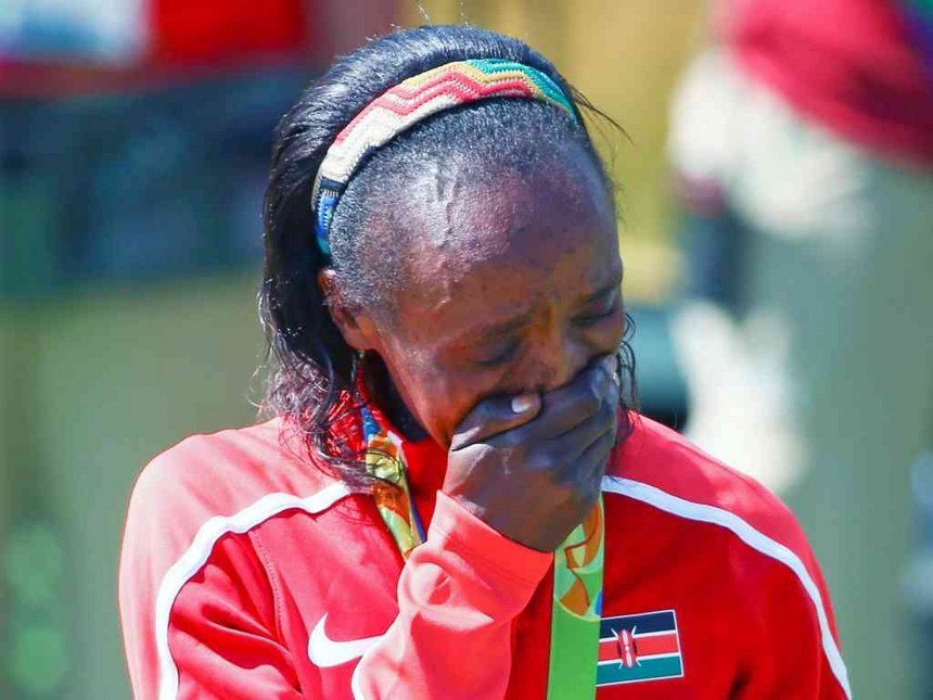 Kenyan athlete leaves many questioning whether she bleached her face & forgot to do the same on her hands