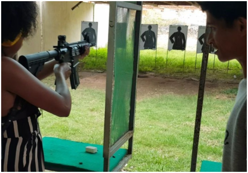 Anita Nderu and her boyfriend enjoy shooting fully automatic assault rifle in Thailand