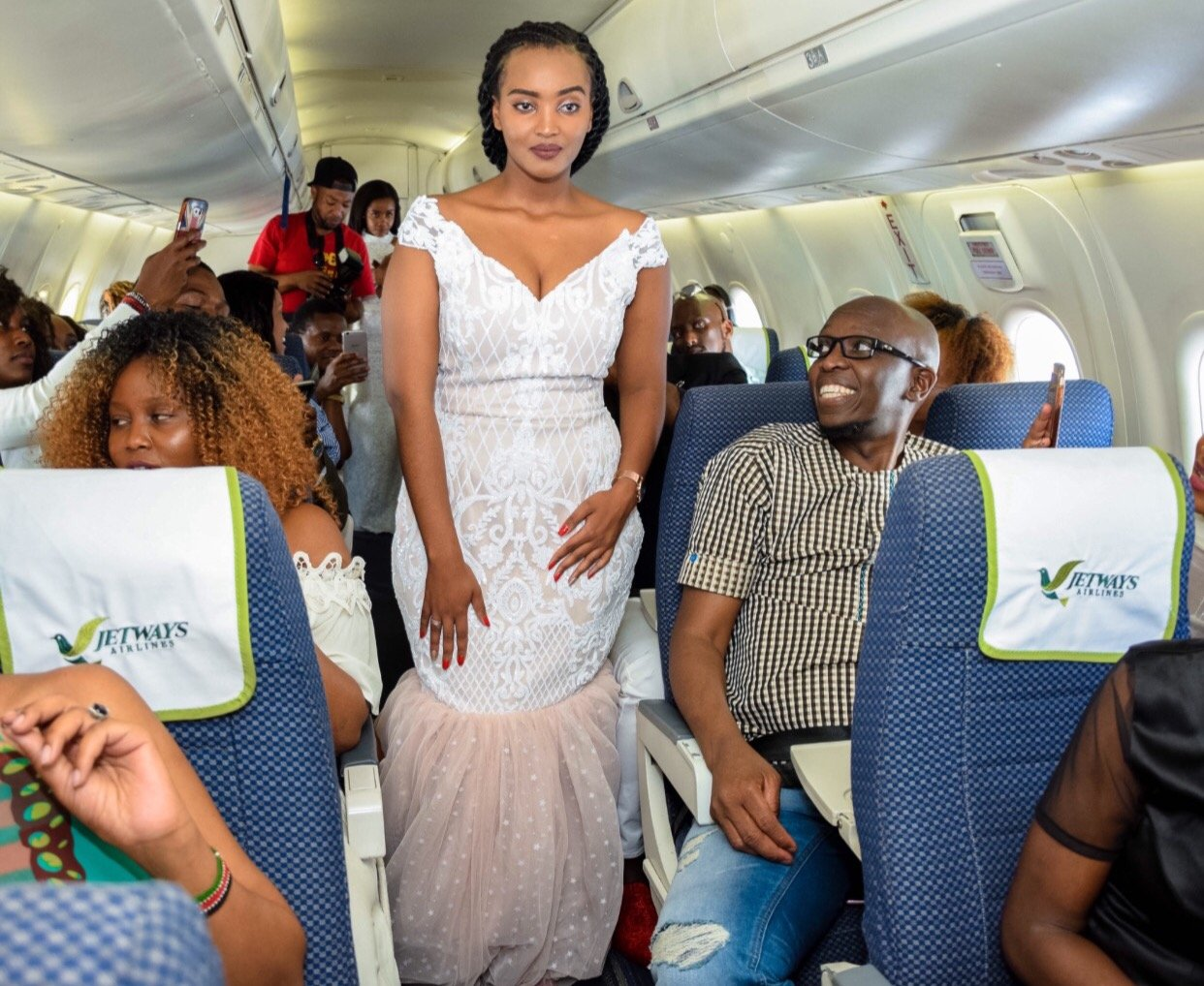 Popular fashion designer holds an in-flight fashion show to showcase her stunning bridal collection (Photos)