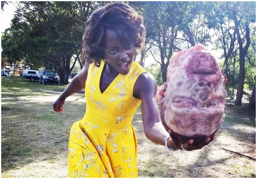 Lupita Nyong'ostrikes terror into netizens as she plays with human head that had been chopped off from the body