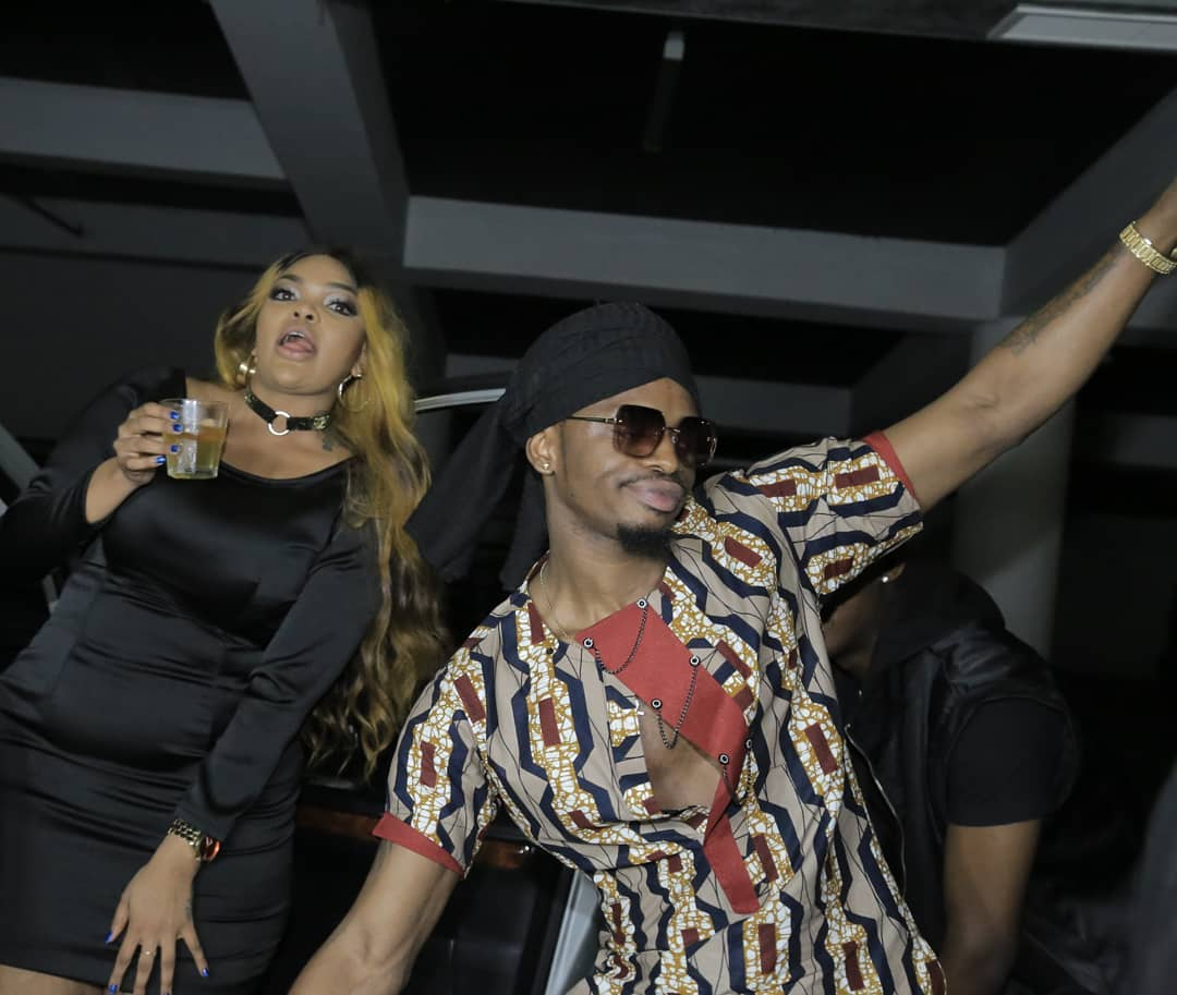 Ouch! Diamond Platnumz rumored side chick attends Wasafi's party and is forced to watch the singer get cozy with Wema Sepetu