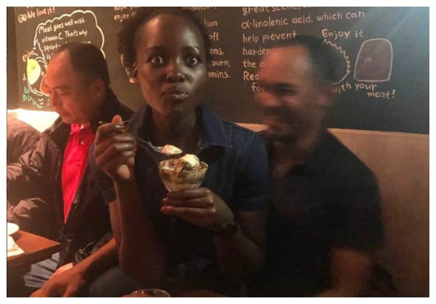 New boyfriend? Lupita Nyong'o leaves internet guessing after she is seen seated on a man's lap at a restaurant (Photos)