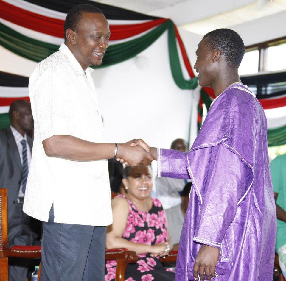 President Uhuru Kenyatta and his adopted son Daniel Owira