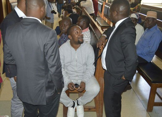 Babu Tale in the courtroom with his legal team