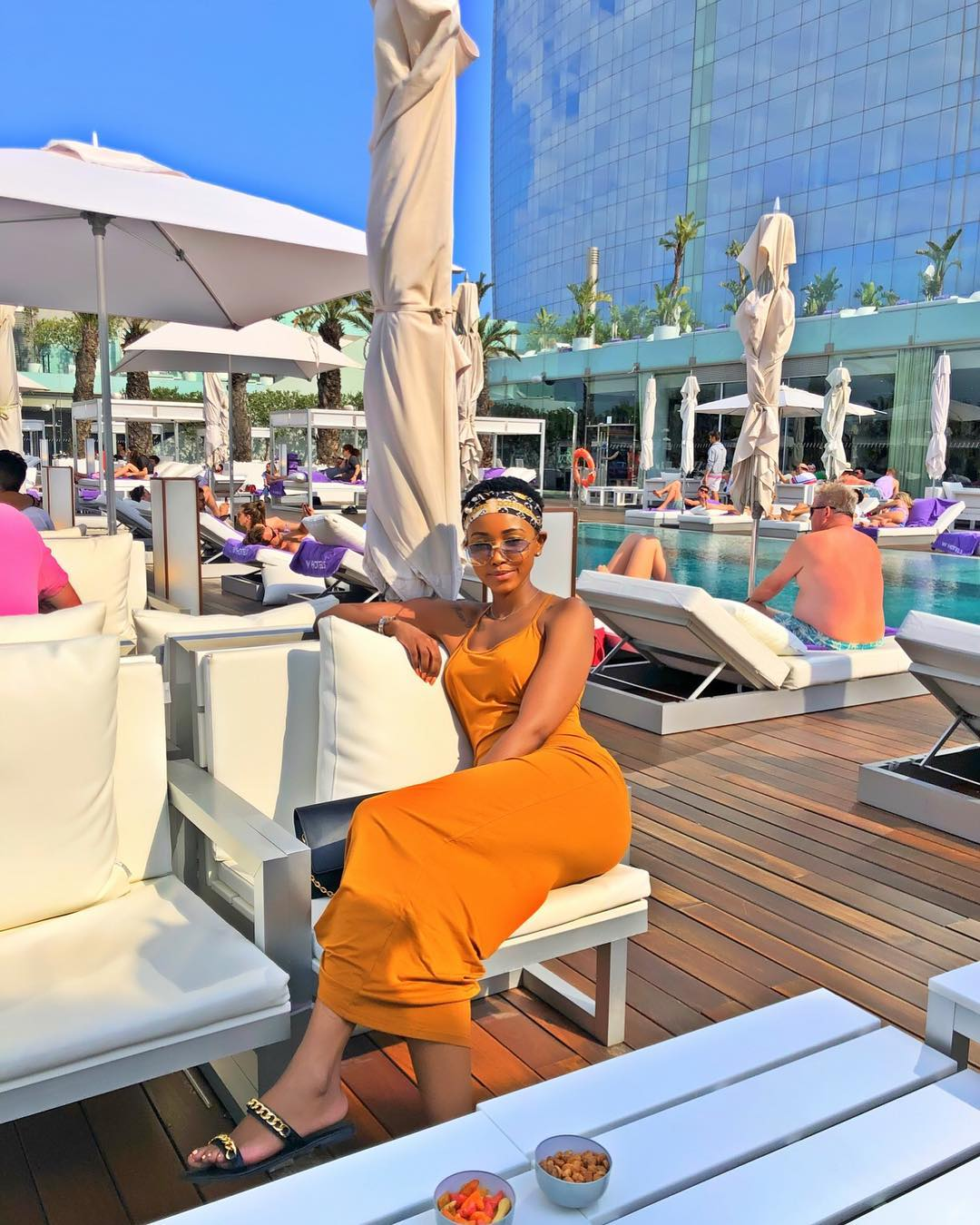 Huddah Monroe having a good time in Barcelona, Spain. Notice the old men in the background.