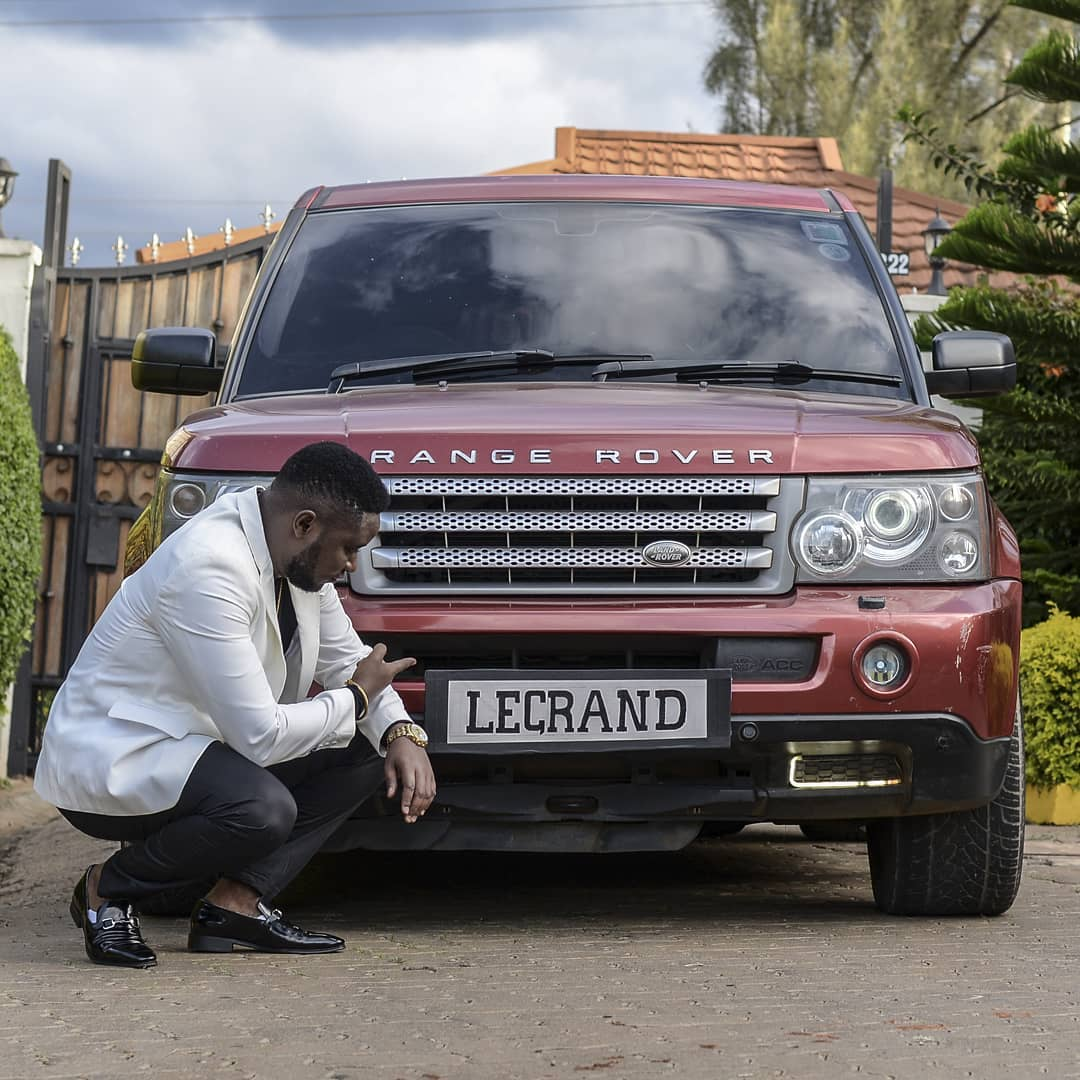 Pitson points at the Range Rover's customized plate which bares his other alias 'LeGrand'.