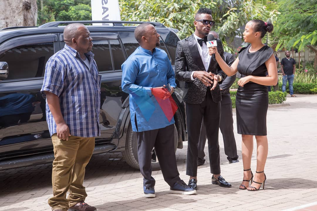 L-R: Diamond's managers Mkubwa Fella, Babu Tale, Diamond and Wasafi TV presenter