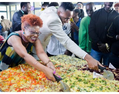 DJ Mo goes down in record books after taking up challenge to eat largest pizza in East Africa (Photos)