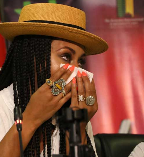 Keri Hilson wipes tears rolling down her face