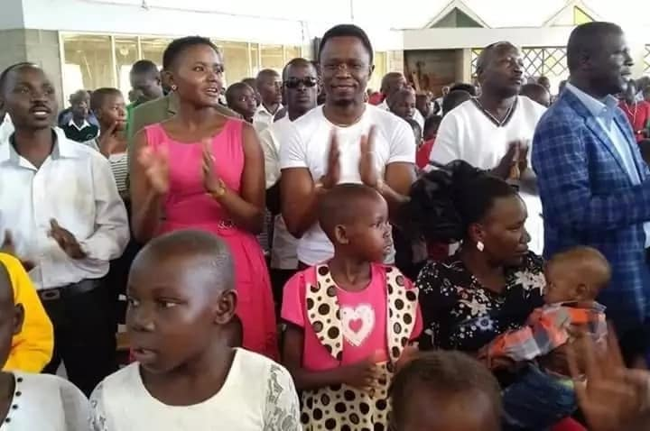 Ababu Namwamba and sweetheart Ann Paula Machio (in pink dress) during the church service