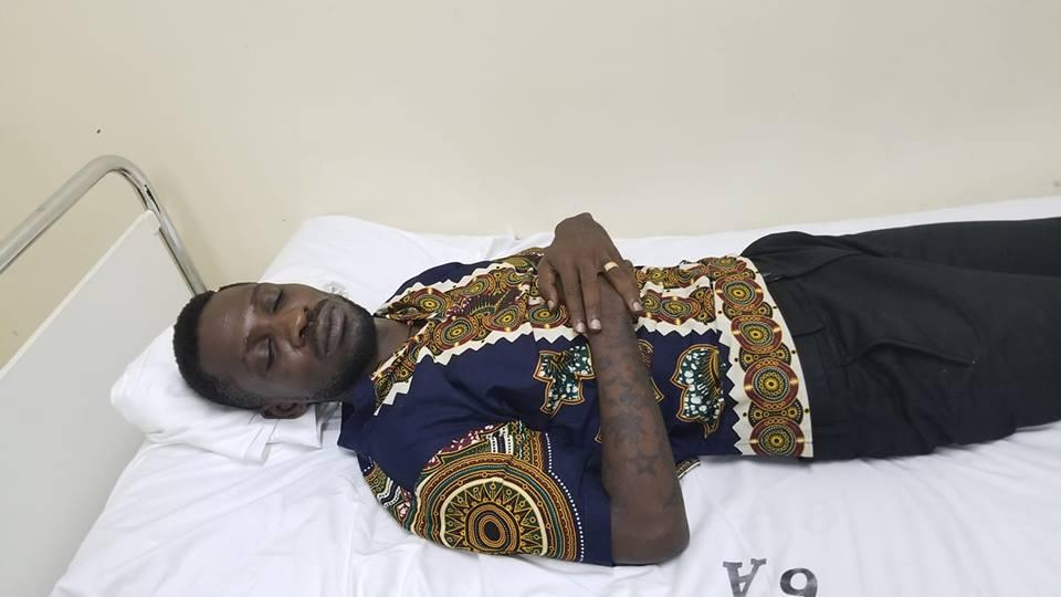 Bobi Wine lies in hospital bed
