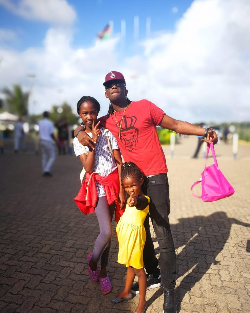 Nameless with his daughters