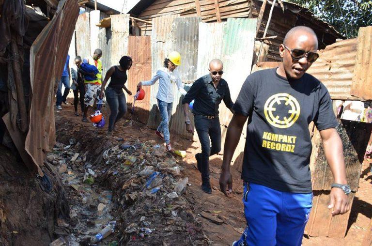Prezzo and Kompakt Records CEO Steve Oh in Kibera slums
