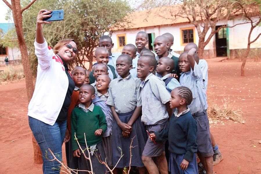 Airtel's Marion Wambua takes a selfie with the pupils at St. Michael Matulani Primary School.