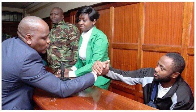 Dennis Itumbi greets Joseph Irungu in court