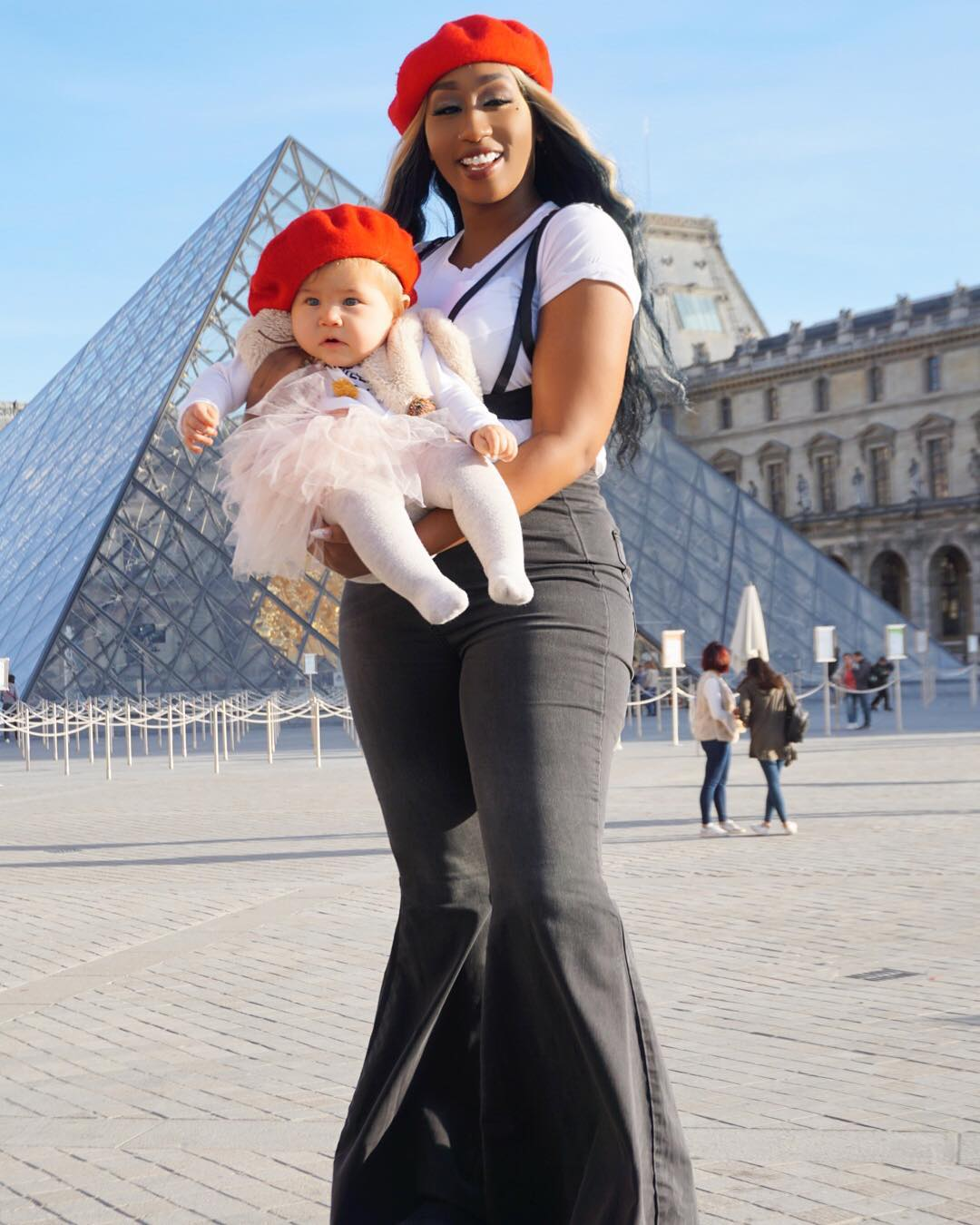 Victoria Kimani poses with a baby in Paris