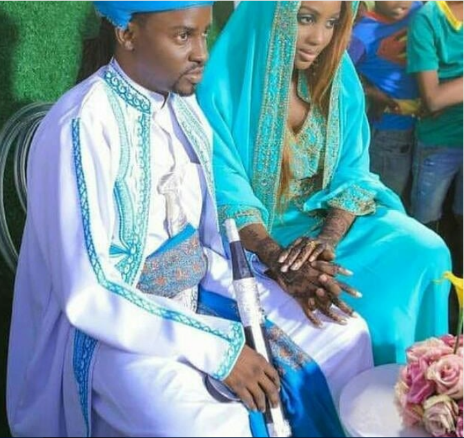 Petit Man with his new wife during their wedding