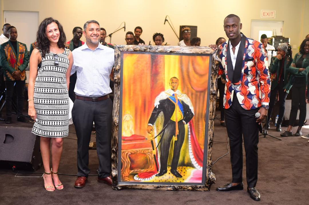 King Kaka holding Eastlando Royalty album cover during the auction