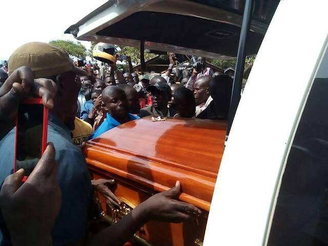 Sharon Otieno's casket being loaded into the hearse