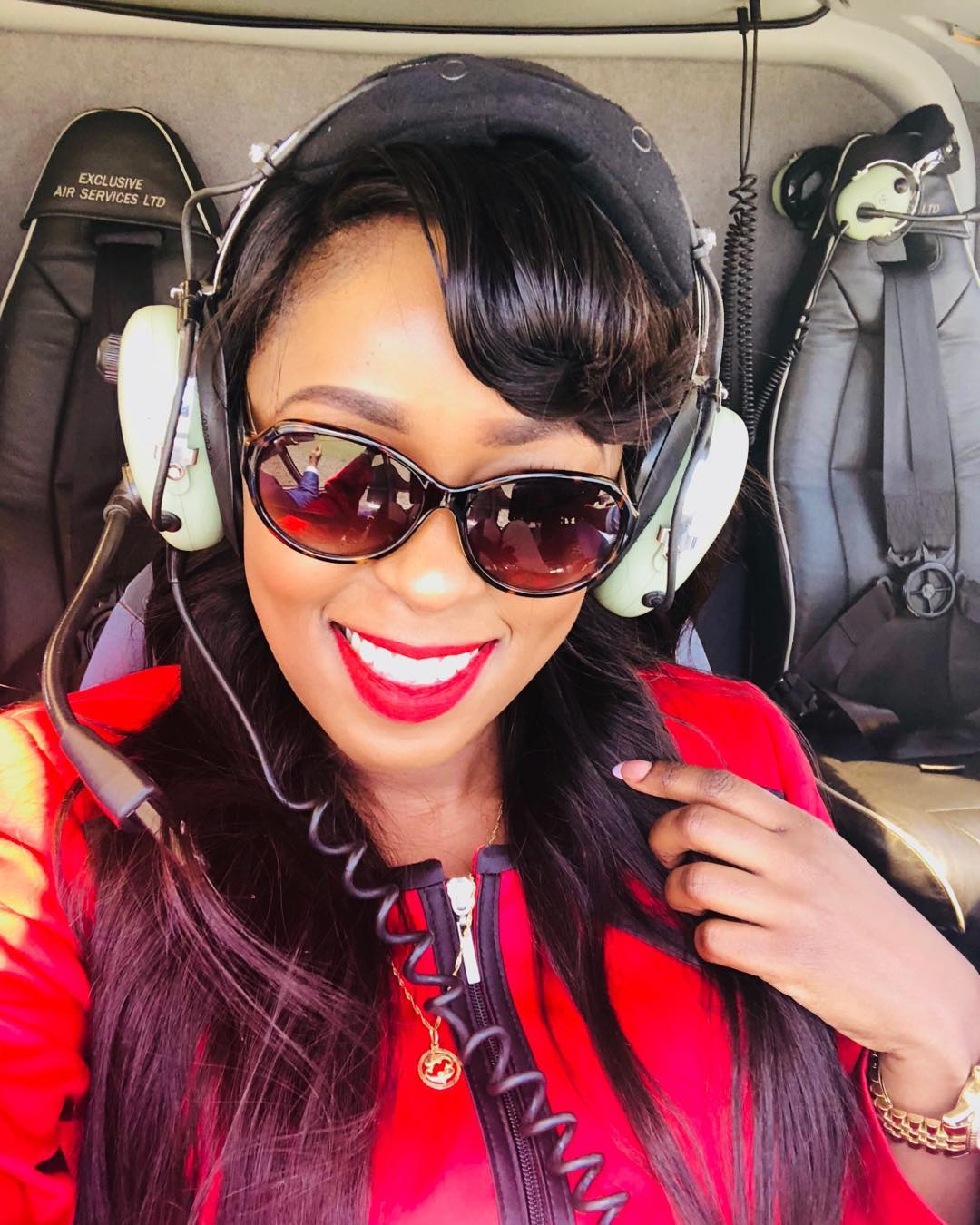 Lillian Muli takes a selfie in the chopper during her trip to Kisii
