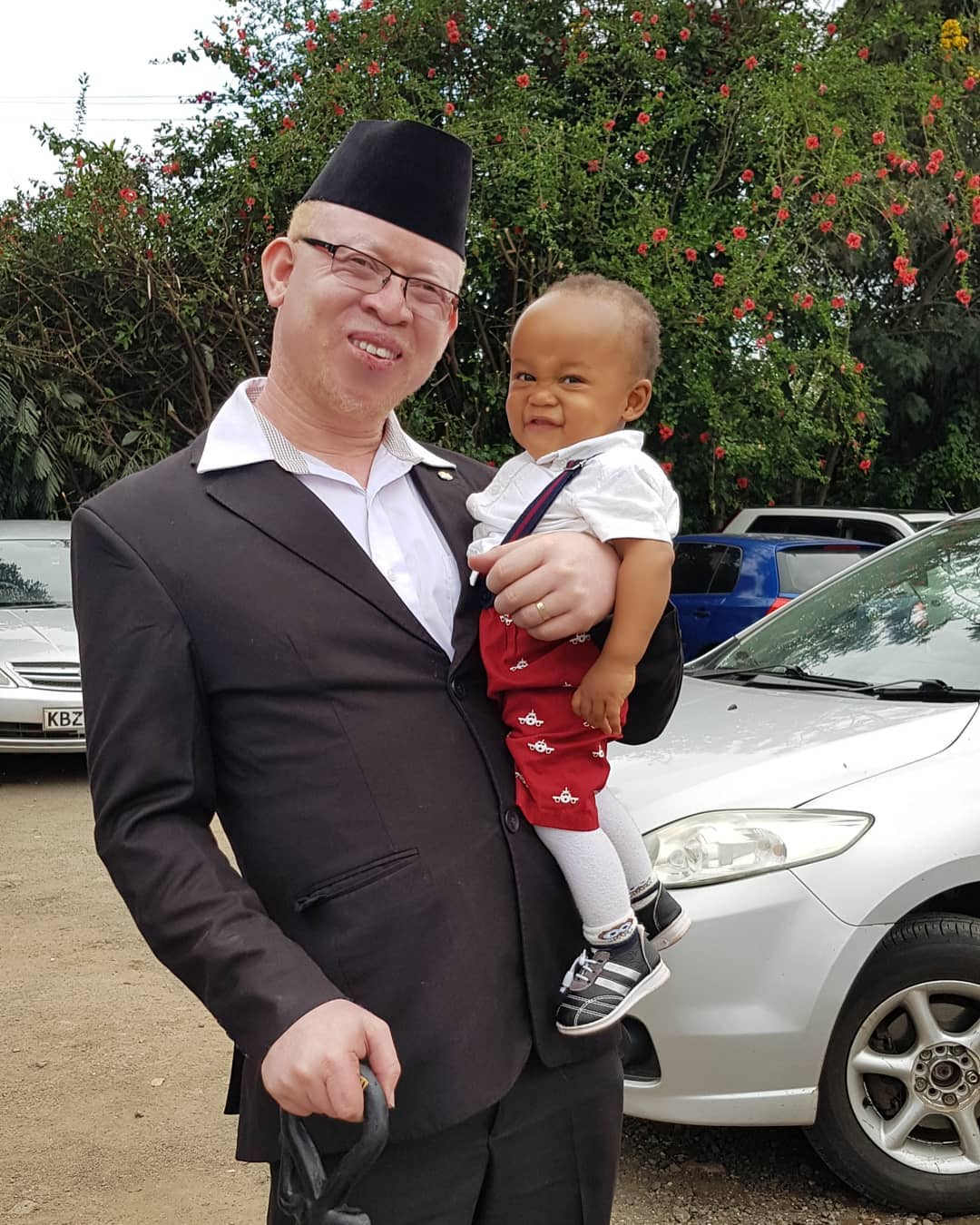 Isaac Mwaura with his son