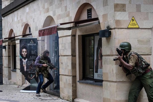 SAS soldier prepares to storm into DusitD2 hotel as a member of Kenyan special forces watches