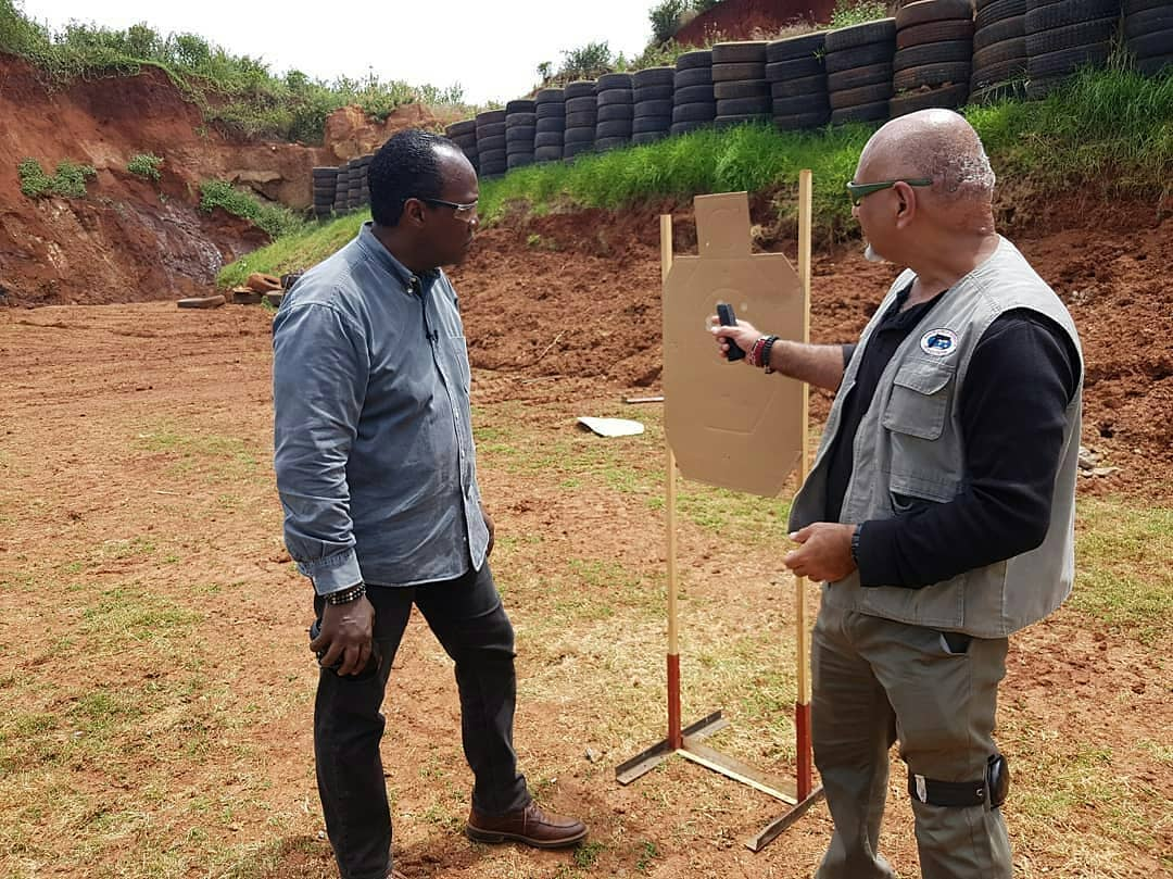 Inayat Kassam and Jeff Koinange at a shooting range