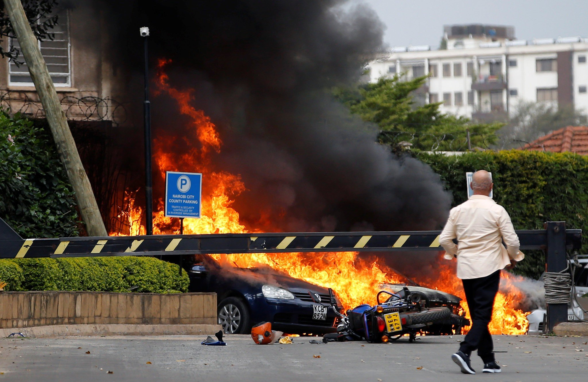 Cars burning outside Dusit hotel after a huge explosion
