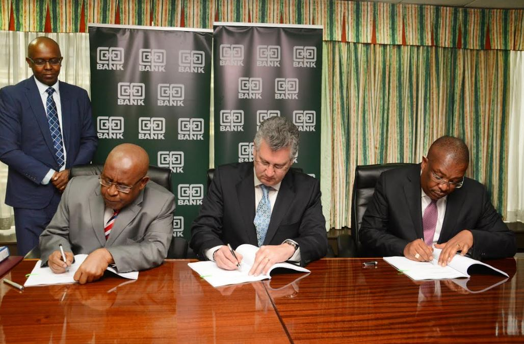 (L-R) The Chairman, Co-operative Bank John Murugu, Fleet Global Chief Operating Officer Super Group, Philip Smith and Group Managing Director and CEO Co-operative Bank Dr. Gideon Muriuki sign-off the joint venture strategic partnership arrangement in leasing business, witnessed by Company Secretary Co-operative Bank Samuel Kibugi (standing).
