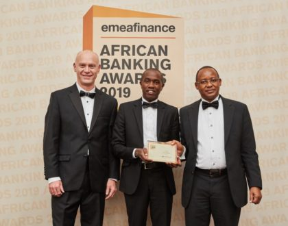 (L-R) The Publisher and CEO EMEA Finance Christopher Moore grants theBest Bank in Kenya 2019Award to Co-op Bank Economist Anthony Muli and Head of Investor Relations and Strategy James Kaburu at the EMEA Awards gala