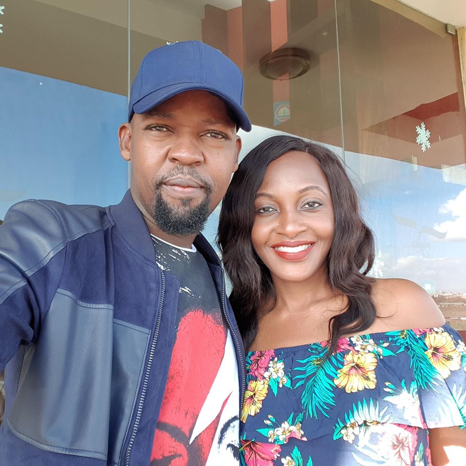 Alex Mwakideu with his wife