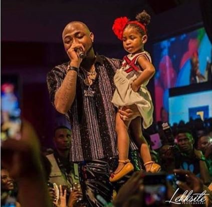 Davido and his daughter, Imade on stage at his 30 billion concert