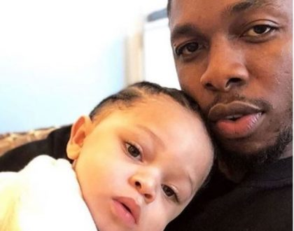 Photo of Runtown and his cute baby boy Zamar