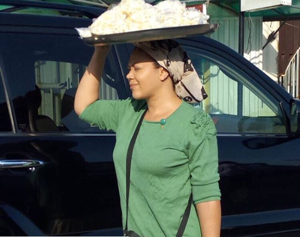 Nadia Buari hawking on the street of Lagos